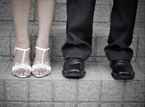 A couples' shoes atop steps of stone